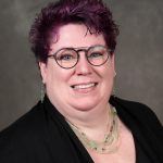 Headshot of Lisa Currie wearing glasses